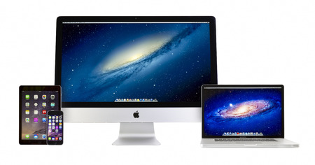 macbook pro: Apple iMac 27 inch desktop computer, Macbook Pro, iPad Air 2 and iPhone 6 on white background. All devices displaying home screen and produced by Apple Inc.