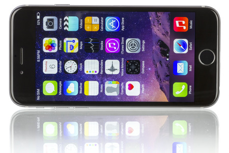 new and improved: Apple Space Gray iPhone 6 showing the home screen with iOS 8.The new iPhone with higherresolution 4.7 screens improved cameras new sensors a dedicated NFC chip for mobile payments. Apple released the iPhone 6 and iPhone 6 Plus on September 9 2014.