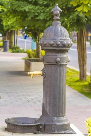 spew: public drinking water tap on street