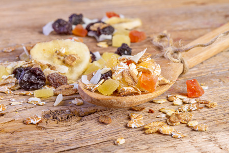 fiber food: cereals muesli food in wooden spoon on wooden background