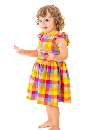 Little girl with hands up on white background