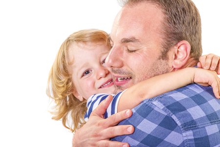 cute little boy: Father hugging his little son with love on white background Stock Photo