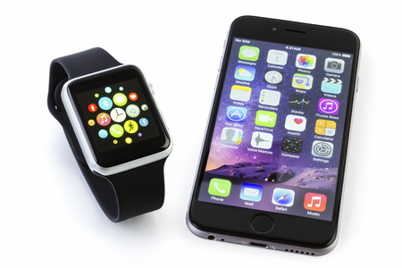galati: GALATI, ROMANIA - FEBRUARY 17, 2016: Apple Watch Sport 42mm Silver Aluminum Case with Black Sport Band displaying the apps screen next to the iPhone 6s displaying the home screen. The Apple Watch is the latest device Editorial