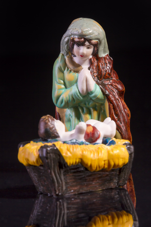 god's cow: Christmas scene with Jesus and Mary on black background. Focus on Mary!