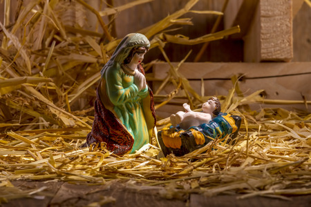 Christmas Manger scene with figurines including Jesus and Mary. Focus on Mary! Stock Photo