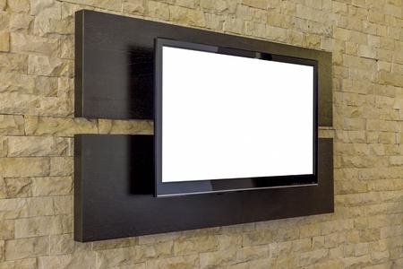 TV display on new brick wall background.  Modern living room interior - TV on brick wall