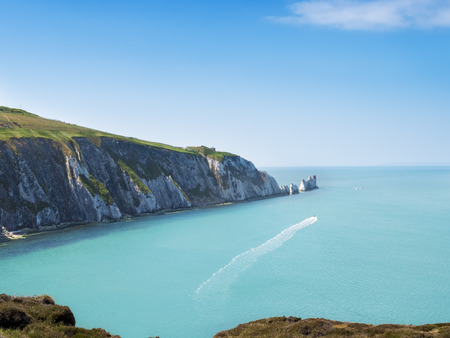 The Needles - is a row of three distinctive stacks of chalk that rise out of the sea off the western extremity of the Isle of Wight, UK, close to Alum Bay.  Stock Photo