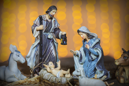 Christmas Manger scene with figurines including Jesus, Mary, Joseph and sheep