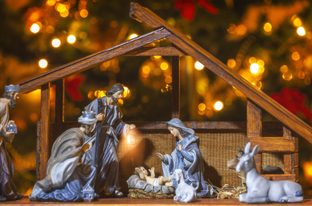 Christmas Manger scene with figurines including Jesus, Mary, Joseph and sheep. Focus on mother!