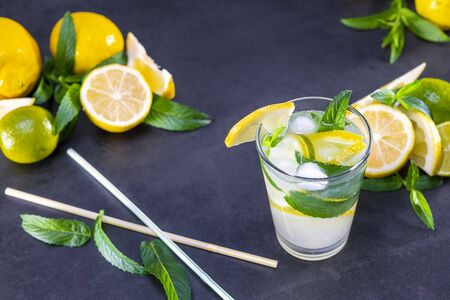Top view of fresh lemonade with mint and ice in glasses on black background. Focus on ice. Zdjęcie Seryjne