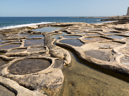seawater: Historic salt pans filled with seawater, Marsaskala, Malta