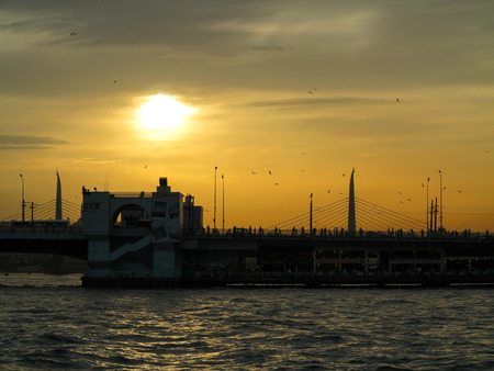 laterns: Silhouettes of angler on the Galata Bridge at sunset, Istanbul