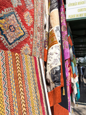 suq: Carpets and fabrics hanging on a market stall, Grand Bazaar, Istanbul