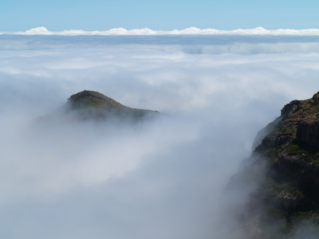 mountaintops: Mountaintops of Madeira Surrounded by Waft of Mist and Clouds