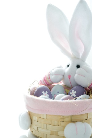 Basket in the form of a hare with Easter eggs photo