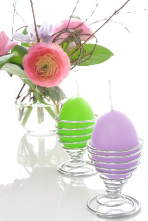 Bouquet of ranunculus with candles in the form of Easter eggs Stock Photo - 8913943