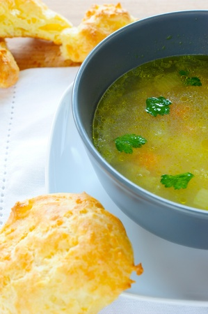vegetable soup of gray pisale on a white linen napkin on a wooden table with three cheese scones photo