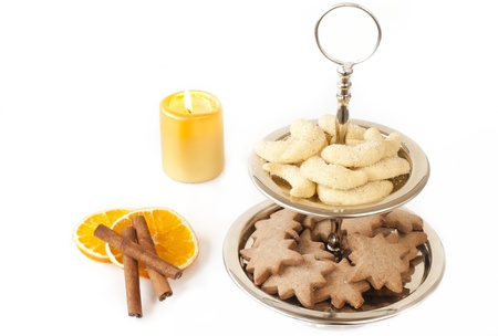 Cookies on the shelf for cookie, top vanilla cones, honey asterisks at the bottom, next to the oranges and cinnamon sticks in the background light golden candle photo