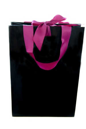 black gift bag with pink ribbons on a white background photo