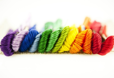cornrows: Embroidery threads of every color of the rainbow on a white background