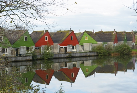 number of similar houses reflected in the water photo