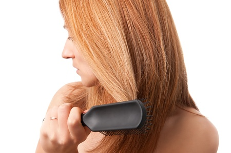 white woman with red hair, brushing her hair, white background photo