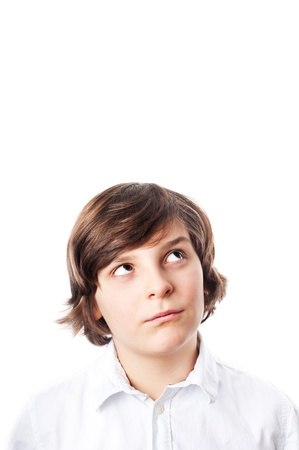 brown hair: White boy with brown eyes and brown hair, wearing a white shirt looking up, white background