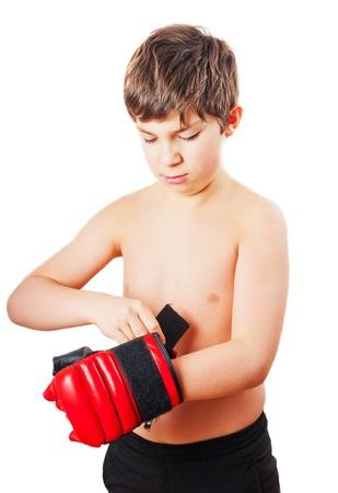 boxing boy: European school-age boy shirtless wearing boxing gloves
