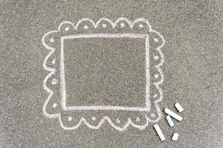 Painted chalk frame on a dark background whit few pieces of chalk Reklamní fotografie - 104489539