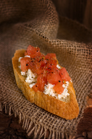 Appetizer. Bruschetta with soft cheese and tomato. Crispy and tasty. photo
