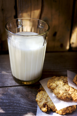 Glass of milk and some sweet cookies photo