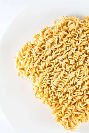 A block of Instant noodles on white background  photo
