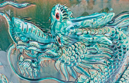 molded: dragon on a wall in a Chinese temple