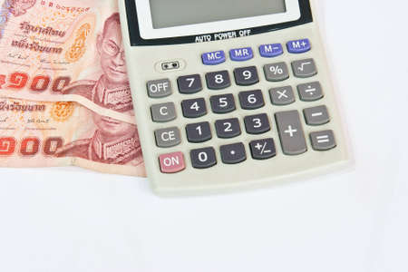 Accounting, Calculator and Thai money  photo