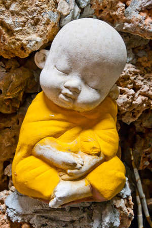 introspection: Earthenware of child monk  Stock Photo