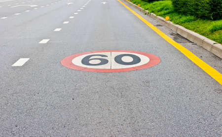 a speed limit sign painted on the road  photo