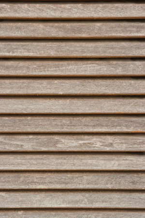 deteriorated: old painted shutters