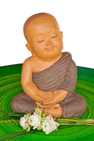 buddhist meditation: Earthenware of child monk  Stock Photo