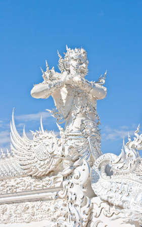 Thai temple called Wat Rong Khun at Chiang Rai, Thailand  photo