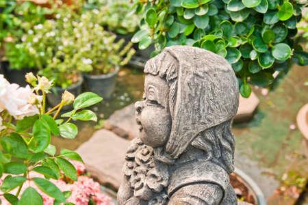 The granite statue of a cute  photo