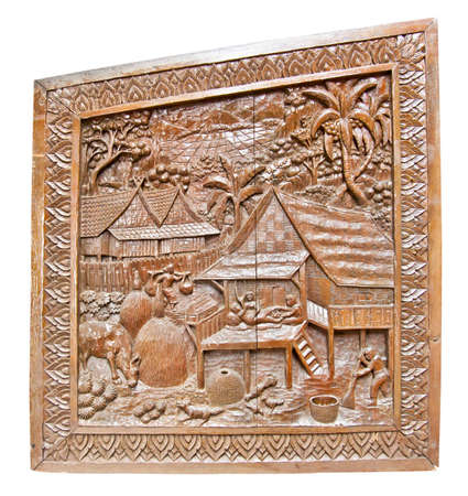 art of wood carving in thai temple photo