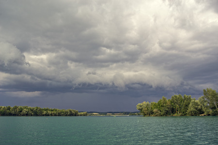 stormy clouds: Stormy clouds over the green lake