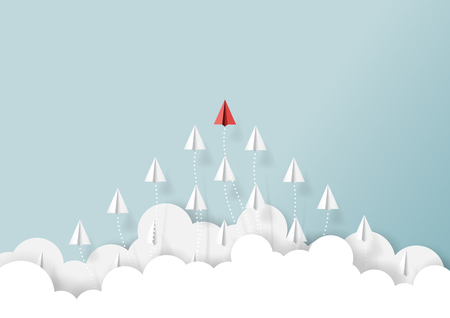 Paper airplanes flying from clouds on blue sky.Paper art style of business teamwork creative concept idea.