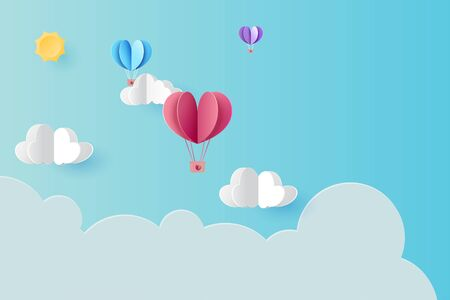 Love concept with hot air balloons floating on blue sky background.