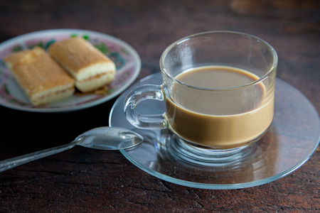 layer cake: Hot coffee in clear glass and layer cake Still life Stock Photo