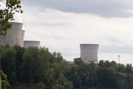 Nuclear chimney stacks from Three Mile Island appears over the trees