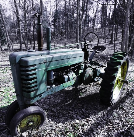 Deserted and neglected old antique tractor Stock Photo - 4369849