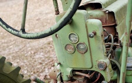 Weathered antique tractor showing steering wheel and gauges Stock Photo - 4369815