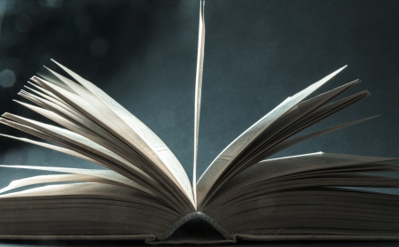 Concept of open book with blue bokeh  Stock Photo