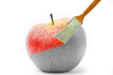 paintbrush painting a fresh red wet apple  photo